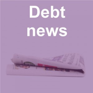 Debt news title and newspaper on purple background